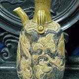 宋代耀州窑褐彩刻花缠枝牡丹纹双系壶